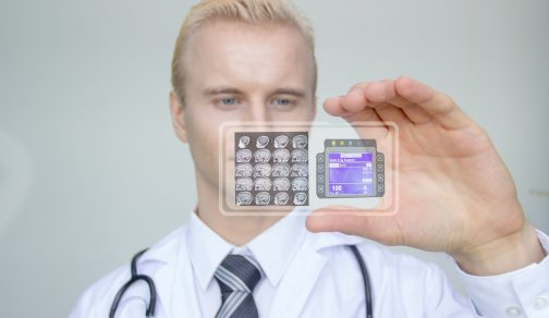 The modern hospital doctor uses a transparent hologram of the phone and looks at the patient's symptoms and treatment.Concept of care and preservation of health in the future.