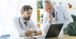 serious-doctors-looking-laptop-screen